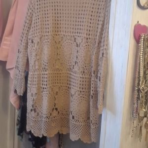 Womens beige crocheted sweater.
